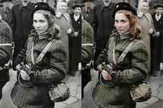 """""""Erika, a Hungarian Freedom Fighter, carries a machine gun in Budapest during the revolution, she was eventually shot by the Soviets"""" Colorized History, World Press, Freedom Fighters, A Whole New World, Lany, Black And White Pictures, Historical Photos, Budapest, Vintage Photos"""