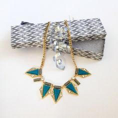 Statement Necklace Golden metal alloy with acrylic faux stones and clear crystals.  Stones are aqua gray color.  22 inches long.  Lightweight.  Shipped in jewelry gift box as shown. Adia Kibur Jewelry Necklaces