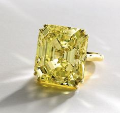 A 52.73 carat, magnificent Fancy Vivid Yellow Diamond Ring