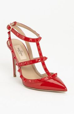 Hands down, I need these red Rockstud Valention's for a holiday party this year!...