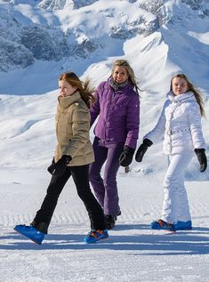 A smiling Queen Maxima of The Netherlands looked glamorous in a purple ski outfit while her daughters Princess Alexia opted for a tan ski jacket in black pants and Princess Ariane in a white ski outfit as they huddle together on the slopes as they kick off their annual family ski holiday in Lech, Australia