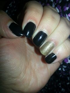 Black with glitter gold accent. Great New Years nails