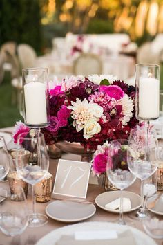 Add marsala orchids, dahlias, and candles to a romantic reception centerpiece, like this design by The Hidden Garden. #WeddingCenterpiece #TableNumber Photography: Samuel Lippke Studios. Read More: http://www.insideweddings.com/news/planning-design/marsala-wedding-ideas-inspired-by-pantones-color-of-the-year/2023/