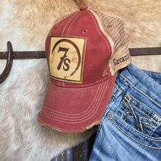 We can't get enough of our new collection of laser graphic leather patch caps! Now in distressed cardinal red  The 7s! Everything about it is so soft and broken in #branded #vintagedestroyed #ranchstyle #deerskinleather #savannah7s