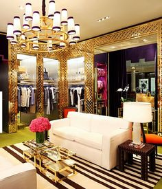 Tory Burch retail space. Her stores are always fantastic and cozy...like you can sit down and stay for a while.