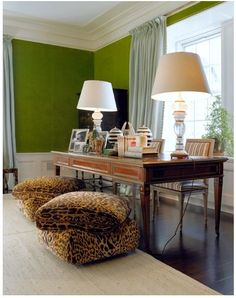 Green velvet walls, large lamps on the desk and large leopard print poufs for lounging