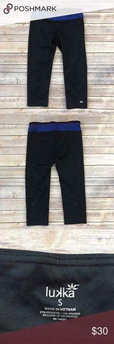 Lukka Lux Athletic Capris Black athletic capris with a purple and blue waistband. Made from 87% Polyester/13% Spandex.  Measures 13 inches across the waist and the inseam measures 18.75 inches. 19862-609 Lukka Lux Pants Capris