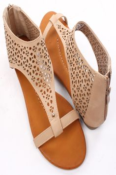 Soft faux leather upper in a flat sandals style with a round open toe, perforated cutouts detail, tonal stitching, back zipper closure. Faux leather lining and footbed. 1/2 inch flat heel. #Fashiongods #BeHot #shoes #Classy #heels #HighFashion #lollicouture