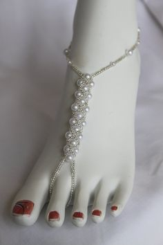 Beach Wedding Bridal Barefoot Sandals Pearl Pattern Foot Jewelry. $39.99, via Etsy.
