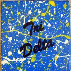 Splatter paint Tri Delta wall decor Delta Girl, Tri Delta, Delta Gamma, Alpha Chi, Big Little Gifts, Sorority Crafts, Sorority Life, Paint Splatter, Hanging Wall Art