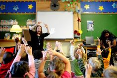 Teacher Jaylene Kostiuk (left) leads an  all-day kindergarten class in song at James S. Bell elementary on the first day of school in 2010. A new study shows that children who were in full-day kindergarten are much better prepared for Grade 1.