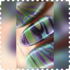 Hello friends!! Here's a watermarble for you!! It was supposed to be a feather watermarble for #clairestelle8mar #flying prompt but although the feathers somewhat #failed  I liked it enough to show you!! What do you think? Products used: @opi_products Nat