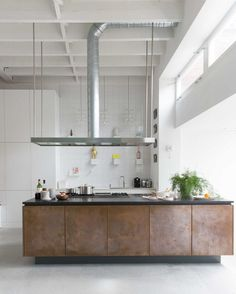 Unusual metallic kitchen cabinets in a large industrial space