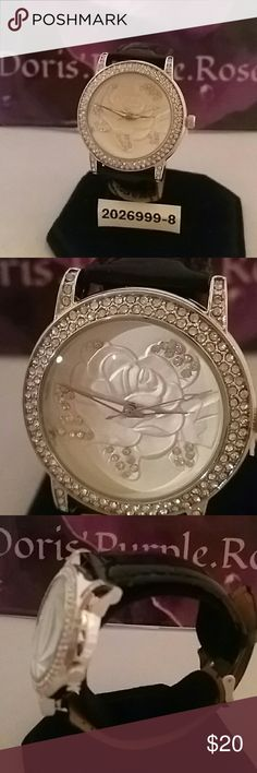 2026999-8. Strata Rose, Crystal Face Watch Beautiful Strata Brand, embossed Silver Rose, Crystal encrusted Face,  Black Patent Watch strap.size up to an 8 inch wrist. Stainless Steel back cover. Genoa Strada Jewelry