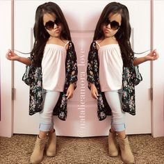 Can't stand the sassy pose and duck lips coming from a child, but how cute is that kimono!