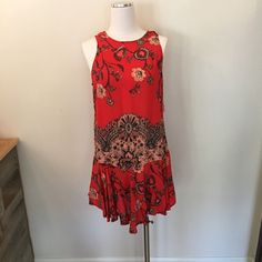 Free people flouncy hem dress Free people flouncy hem dress features scoop back with tie closure and flouncy hem detailing.  100% rayon. This item is NWT retail, it has never been sold before and is in perfect condition. No trades so please don't ask  Free People Dresses