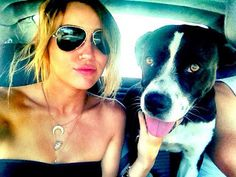 Miley Cyrus    The 19-year-old singer recently adopted a new black and white dog named Mary Jane, sharing the news and photos with her fans via Twitter.
