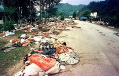 17 July 1995: Belongings of Srebrenica massacre victims litter a road after the mass execution of men and boys