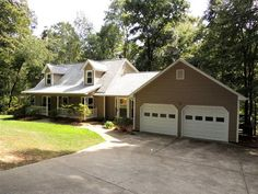 ACREAGE 4.82 AC Beautiful Privacy Enjoy nature and live on the South Tyger River Winding wooded drive to the home thats nestled in the sunny opening with a large front porch and you will enjoy all the updates and extras in this home that is in move in condition Huge Great Room formal dining room thats currently used as a study Master on the main level all updated bathrooms.  The kitchen has an updated gas stove and French door stainless refrige.