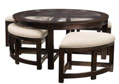 Appropriately named, the Four Corners Occasional Tables offer elegance, beauty and sophistication. Glass and wood combination, The wood features a beautiful merlot finish, Intricate top makes for a wonderful display, Coordinating Dinette and End Table also available.