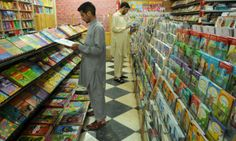 Men read books at a bookshop in Peshawar, Pakistan today: UNESCO World Book and Copyright Day. By celebrating World Book Day throughout the world, the organisation seeks to promote reading, publishing and the protection of intellectual property through copyright.
