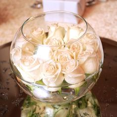 A bowl of floating white roses adds easy elegance to a @Mandy Dewey Seasons Hotel Cairo at The First Residence wedding.