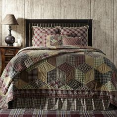Tumbling blocks quilt pattern in burgundy, green, tan, and creme plaids makes this a rustic/lodge winner for your room. Coordinating bed skirt is  available along with chocolate burlap window treatments, tobacco cloth khaki curtains, or our popular Carrington valances and panels. This quilt comes in all quilt sizes from Country Porch Home Decor. 866-664-9182