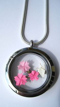 Floating Locket Necklace with Origami Charm Cherry Blossoms and a Paper Crane with Sterling Silver Chain This one of a kind necklace features a miniature origami crane resting on a cherry blossom branch with three beautiful blooming cherry blossoms.
