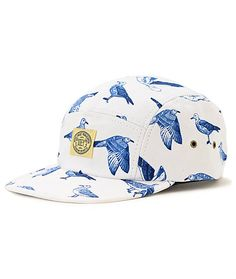 Send your summer style soaring to new heights with the sleek Obey Gulls white 5 panel hat. Stand out with the blue seagulls print on a white 5 panel with metal eyelets for ventilation on hot days and an adjustable strapback sizing piece so you get the per