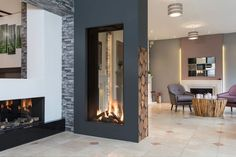 Visit The Fireplace Studio showroom in Bramcote to see our range of premium fires and fireplaces including modern gas and electric fireplace suites. Fireplace Showroom, Home Fireplace, Modern Fireplace, Living Room With Fireplace, Home Living Room, Living Room Designs, Fireplace Glass, Outdoor Fireplaces, Living Spaces