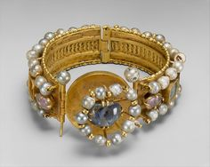These elaborately decorated bracelets have richly jeweled exteriors and finely detailed opus interrasile patterns on their interiors. The luminous beauty of pearls was highly prized in the Byzantine world