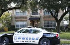 A police car stands outside the apartment complex of the infected health worker in Dallas, 12 October