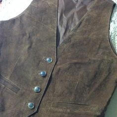 Leather vest Genuine leather vest, lining is 100% nylon . This has badge buttons and is brown. Pull on them boots , throw this on and head out to your favorite concert or rodeo .. Greatland  Jackets & Coats Vests