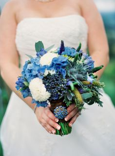 lovely, but almost too much blue?    a bouquet of blue aggies, blue hydrangea, blue thistle, white dahlias, green seeded euc, blue viburnum berry, blue veronica, and green millet. The Full Bouquet blog!
