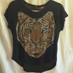 Say What? Tiger shirt Say What?, size M, black with brown/black and white Tiger face pattern, very short sleeves, light sweater like material, short zipper in back, slight hi-lo hem line, 70% rayon 30% polyester top. Say What? Tops