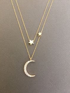 Simple and elegant 18K Gold over 925 sterling silver Vermeil CZ Embdedded crescent Moon charm and 18K Vermeil stars on Gold filled chain. Also available in 925 Sterling silver.  *This is two separate necklaces.   *Moon Measures approx. 15mm x 20mm *Star measures 6mm  *Choose your Message card that goes with the necklace. Happy Birthday Happy Valentines Day Happy Mothers Day Just Because Congratulations Or a personal Message…