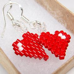 Here is a cute pair of heart earrings on sterling silver earwires that would make a great gift for a teen girl on Valentines day. The hearts are light