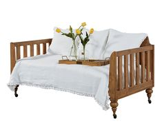Daybeds are a great idea because they offer a place to sit and a place to sleep. Our Primitive Daybed, with its paneled back and slat ends is perfect for a bedroom, or to tuck in a sun porch or office as an extra bed for company. Plus, it comes with casters so you can move it here or there and comes in a Bench wood finish. This Daybed also comes in Jo's White painted finish.