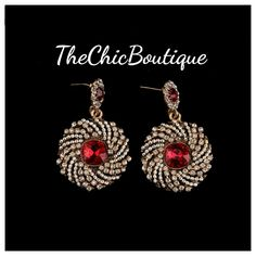 These earrings have a beautiful spiral design and  a red center stone. Fast and free shipping in the U.S. | Shop this product here: http://spreesy.com/TheChicBoutique/167 | Shop all of our products at http://spreesy.com/TheChicBoutique    | Pinterest selling powered by Spreesy.com