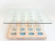 Possible but I'd paint the bottles or fill with shells or stones