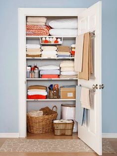 "still love this linen closet.just wish my linen ""closet"" was an actual closet with one door and not 3 separate cabinets.Use a towel rod on the inside of the linen closet for holding blankets. Linen Closet Organization, Organization Hacks, Closet Storage, Organizing Ideas, Organising, Bathroom Organization, Bathroom Storage, Bathroom Towels, Airing Cupboard Organisation"