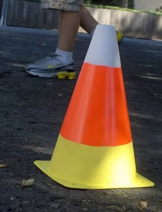 Candy Corn from orange cones...so cute and easy! I found some cones like this and smaller ones at home depot in the construction area with the tools. This would be a great prop for a racing game at a party during the holidays like balancing a pumpkin on your head while going around the cone and back.