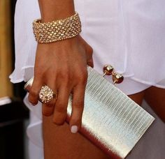 So my style...............the bracelet, ring and clutch. Not sure about the skirt? dress? Um, how about putting some long white pants on, sweetie......