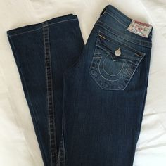 "True Religion Jeans - Joey 100% Authentic -  True Religion Jeans. Style Fit is ""Joey"".  Size is 27. Inseam is 33 inches. Excellent condition, no rip, no stains, no marks. Price is negotiable and I'm always open to all offers. NO TRADES True Religion Jeans Boot Cut"