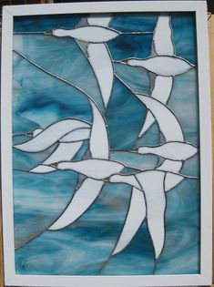 Six white snow geese on a blue background. Overall item measures 18.25 inches by 25 inches. Mounted in a white wooden frame. Two brass eye hooks on sides for hanging by chain (not included). Items ships free in continental US. Hawaii and Alaska customers please write me for a separate surcharge.    100% SATISFACTION GUARANTEE. If you receive this item and decide within one week that you do not like it, I will refund your full purchase price,    I am not a new seller on Etsy. See my other…