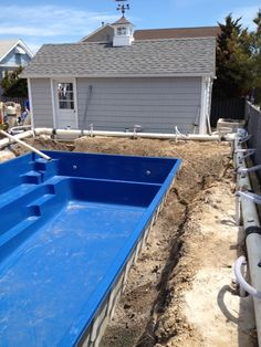 12:45 The pool is set into the ground.  Looking nice!