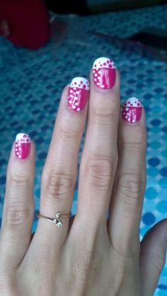 Hot pink French manicure with white tips and polka dot detail nail art. #nails #nailart #manicure