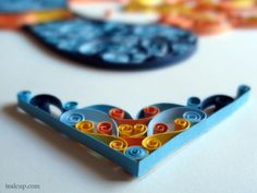 Example of corner quilling - quiller's name on photo.
