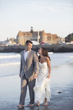Walking on Narragansett Town Beach after the wedding...love Narragansett Towers in the background! Nicole Miller Dakota dress Photo By Carly Michelle Photography #RhodeIslandwedding #thetowers