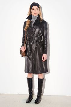 Black leather trench coat and flat sole black patent leather boots